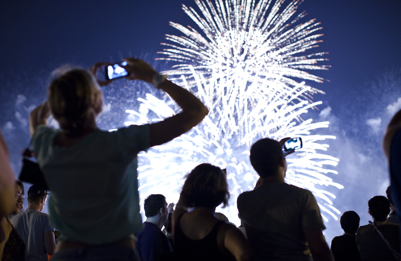People Recording Fireworks Display